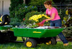 Follow link to the 10P Utility Cart fits Ride-on and EZtrak Mowers product page.